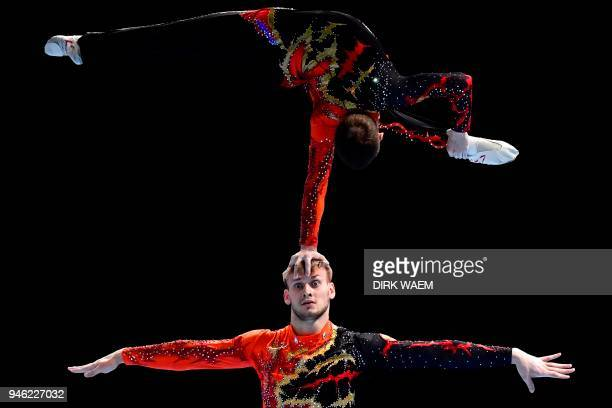Russia's Igor Mishev and Nikolay Suprunov compete in the men's final pair event on the second day of the 26th edition of the Acrobatic Gymnastics...