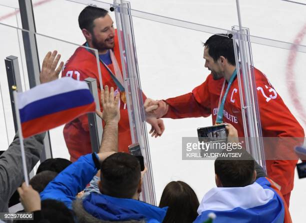 Russia's Ilya Kovalchuk and Russia's Pavel Datsyuk celebrate the gold after the medal ceremony in the men's gold medal ice hockey match between...