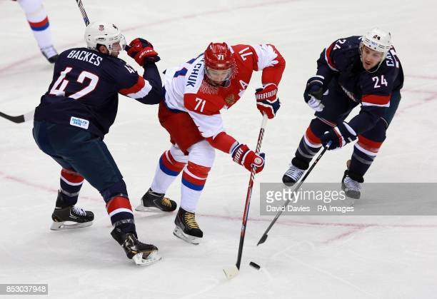 Russia's Ilya Kovalchuk is tackled by USA's David Backes and Ryan Callahan during their Preliminary round match at the Bolshoy Ice Dome during the...