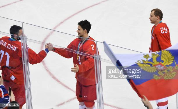 Russia's Ilya Kovalchuk Russia's Artyom Zub and Russia's Ilya Kablukov celebrate the gold after the medal ceremony in the men's gold medal ice hockey...