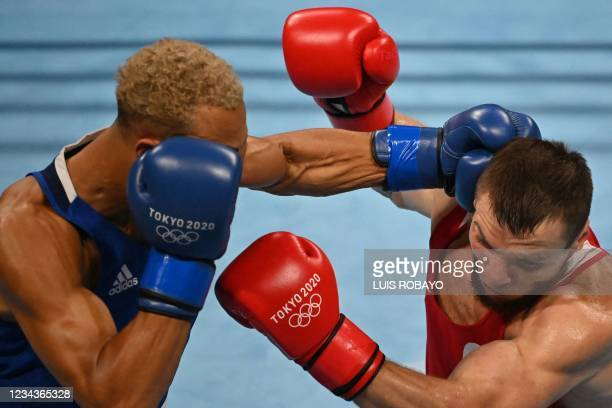 Russia's Imam Khataev and Britain's Benjamin Whittaker fight during their men's light heavy semi-final boxing match during the Tokyo 2020 Olympic...