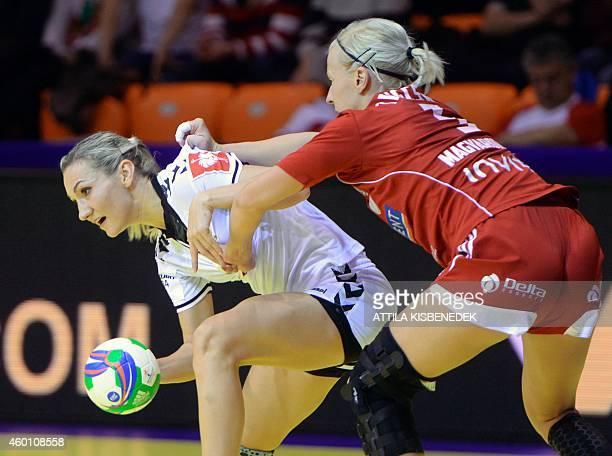 Russia's Irina Bliznova vies with Hungary's Krisztina Triscsuk during the match Hungary vs Russia at the 2014 European Women's Handball Championships...