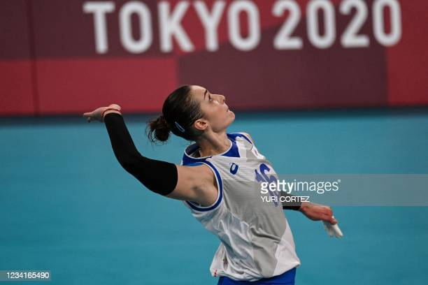 Russia's Irina Voronkova serves in the women's preliminary round pool B volleyball match between Russia and Italy during the Tokyo 2020 Olympic Games...