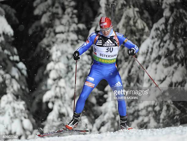 Russia's Ivan Tcherezov competes during the Men's World Cup Biathlon 20km individual race on December 3 2008 in Ostersund Sweden Germany's Michael...