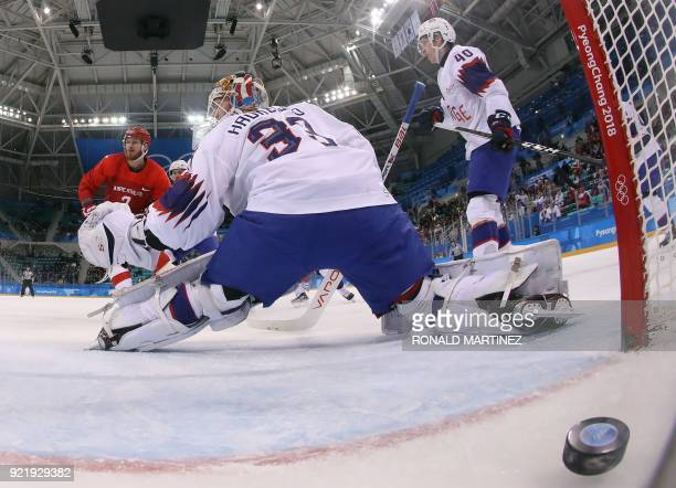 Russia's Ivan Telegin scores a goal during the men's quarter-final ice hockey match between Norway and the Olympic Athletes from Russia during the...