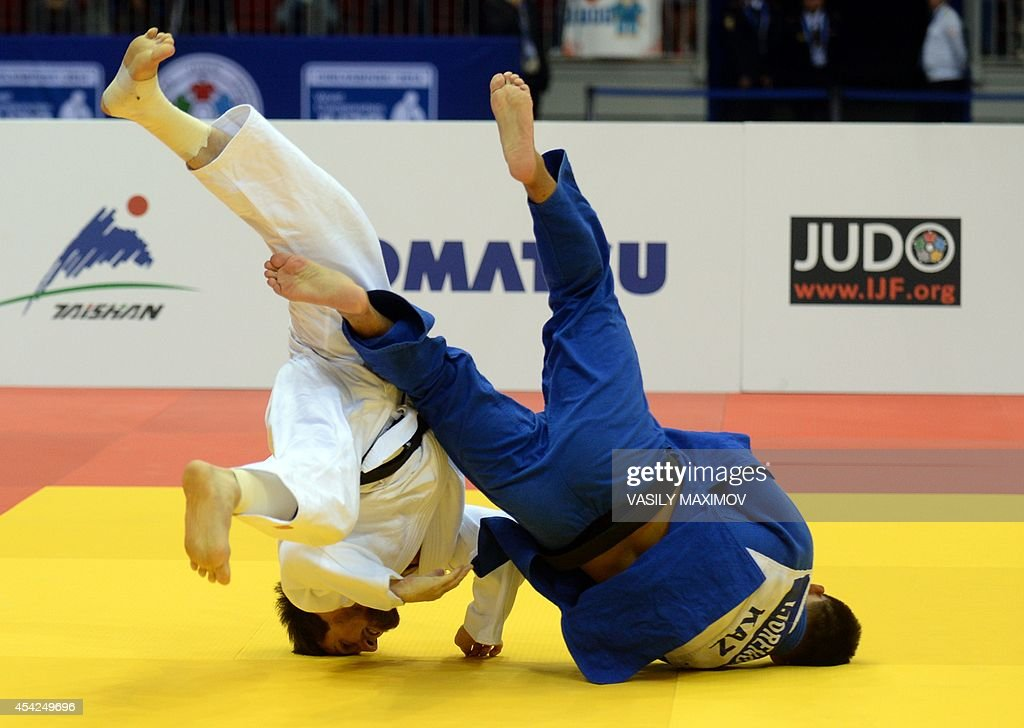 Russia's judoka Musa Mogushkov (white) competes with Kazakhstan's Yertugan Torenov during the under 73 kg category competition for bronze medal at the IJF World Judo Championship in Chelyabinsk on August 27, 2014.