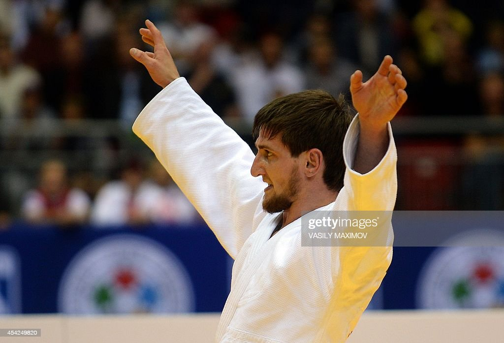 Russia's judoka Musa Mogushkov reacts as he wins against Kazakhstan's Yertugan Torenov during the under 73 kg category competition for bronze medal at the IJF World Judo Championship in Chelyabinsk on August 27, 2014.