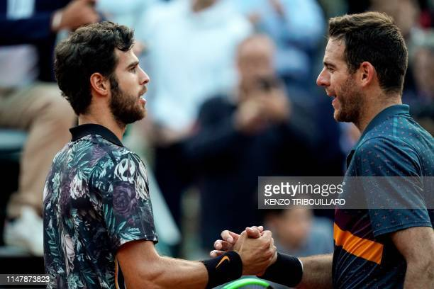 TOPSHOT Russia's Karen Khachanov and Argentina's Juan Martin del Potro shake hands at the end of their men's singles fourth round match on day nine...