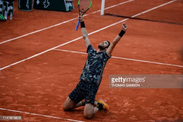 TOPSHOT Russia's Karen Khachanov celebrates after winning against Argentina's Juan Martin del Potro at the end of their men's singles fourth round...