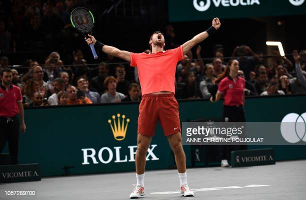 Russia's Karen Khachanov celebrates after winning against Serbia's Novak Djokovic at the end of their men's singles final tennis match on day seven...