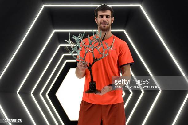 Russia's Karen Khachanov poses with the trophy after winning against Serbia's Novak Djokovic the men's singles final tennis match on day seven of the...