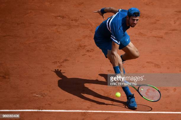 Russia's Karen Khachanov returns the ball to Germany's Alexander Zverev during their men's singles fourth round match on day eight of The Roland...