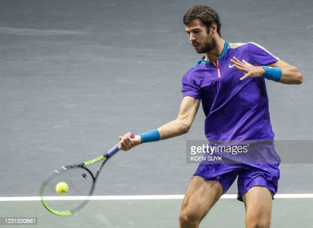 Russia's Karen Khachanov returns the ball to Greece' Stefanos Tsitsipas on the fifth day of the ABN AMRO World Tennis Tournament in Rotterdam, The...