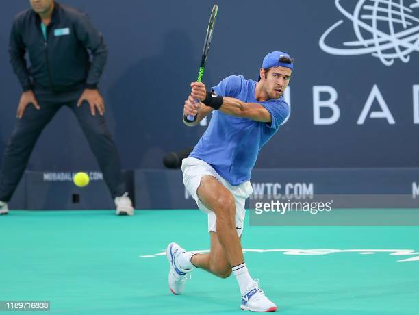 Russia's Karen Khachanov returns the ball to Serbia's Novak Djokovic during the Mubadala World Tennis Championship 3rd Place match at Zayed Sports...