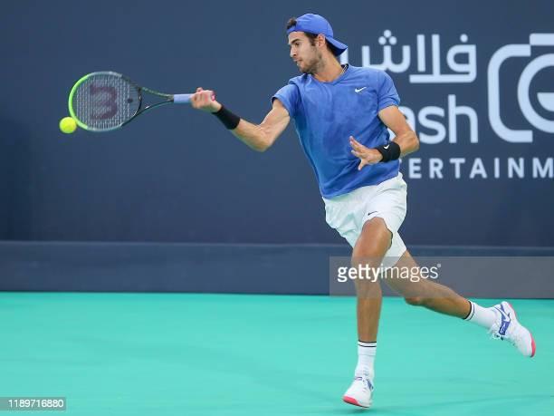 Russia's Karen Khachanov returns the ball to Serbia's Novak Djokovic during the Mubadala World Tennis Championship 3rd Place match at Zayed Sports...