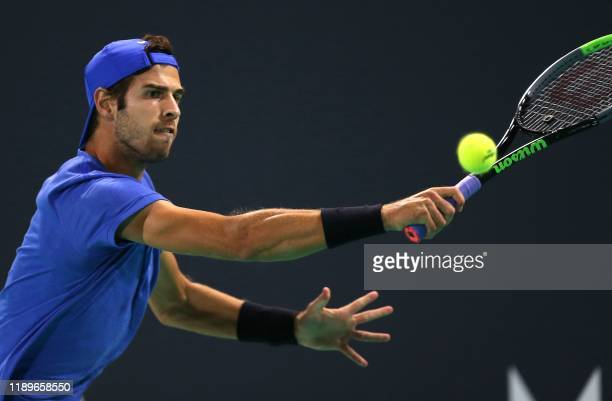 Russia's Karen Khachanov returns the ball to Spain's Rafael Nadal during a semi-final match of the Mubadala World Tennis Championship at Zayed Sports...