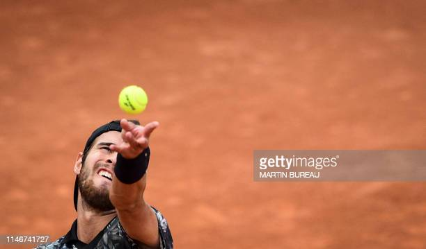 Russia's Karen Khachanov serves the ball to Germany's CedrikMarcel Stebe during their men's singles first round match on day three of The Roland...