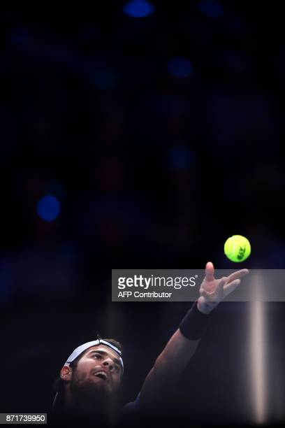 Russia's Karen Khachanov serves to US' Jared Donaldson during their men's singles tennis match of the first edition of the Next Generation ATP Finals...