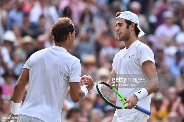Russia's Karen Khachanov shakes hands with Spain's Rafael Nadal after Nadal won their men's singles third round match on the fifth day of the 2017...