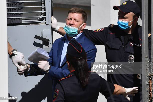 Russia's Khabarovsk region governor Sergei Furgal is escorted into a police van after a court hearing in Moscow on July 10 2020 A Moscow court on...