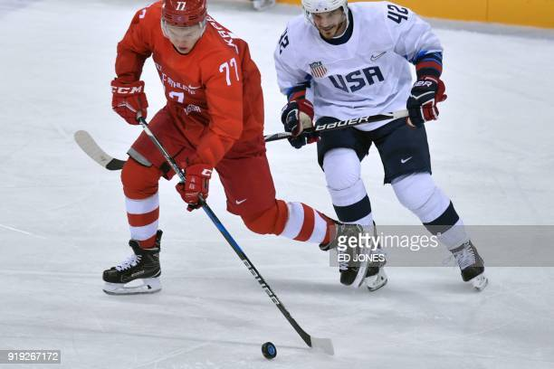 Russia's Kirill Kaprizov and US Chad Kolarik vie for the puck in the men's ice hockey preliminary round group B game between the Olympic Athletes...