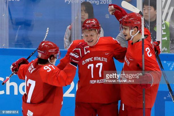 Russia's Kirill Kaprizov celebrates scoring with teammates Nikita Gusev and Artyom Zub in the men's preliminary round ice hockey match between the...
