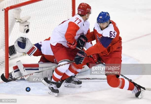TOPSHOT Russia's Kirill Kaprizov clashes with Czech Republic's Vojtech Mozik in the men's semifinal ice hockey match between the Czech Republic and...