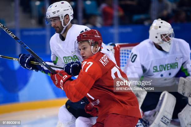 Russia's Kirill Kaprizov fights for the puck in the men's preliminary round ice hockey match between the Olympic Athletes from Russia and Slovenia...