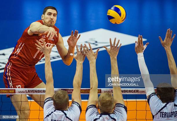 TOPSHOT Russia's Kostyantin Bakun spikes the ball during the pool B match Finland vs Russia of the 2016 Men's Volleyball Olympic Qualification...