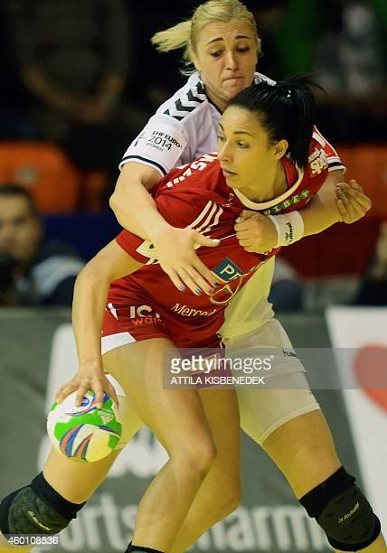 Russia's Ksenia Makeeva vies with Hungary's Zita Szucsánszki during the match Hungary vs Russia at the 2014 European Women's Handball Championships...