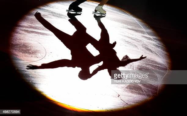 Russia's Ksenia Stolbova and fedor Klimov are shadowes on ice as they perform during the gala exhibition after the ISU Grand Prix Figure skating...