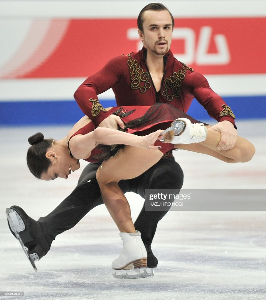 Russia's Ksenia Stolbova (L) and Fedor Klimov perform during the pair's short program at the world figure skating championships in Saitama on March 26, 2014.
