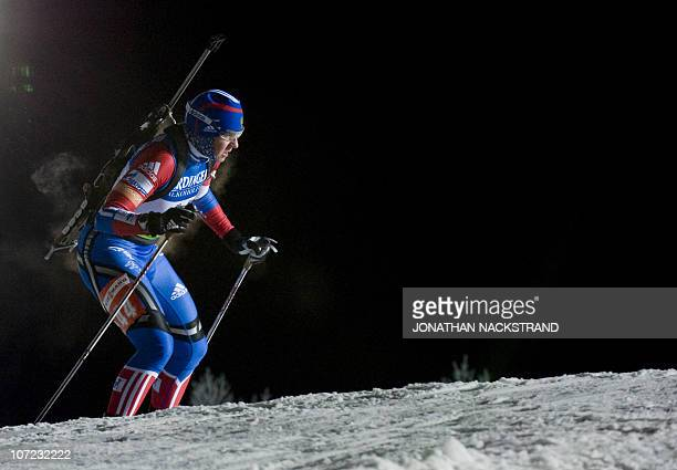 Russia's Lana Romanov skis on her way to the 5th place at the Women's Biathlon 15km individual race on December 1 2010 in Oestersund Sweden AFP...