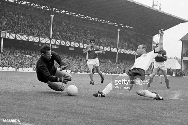Russia's Lev Yashin dives to catch the ball kicked by West Germany's centreforward Uwe Seeler during the World Cup semifinal at Goodison Park...