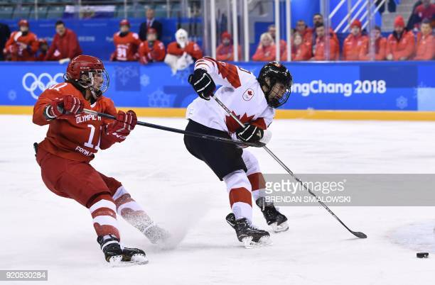 Russia's Liana Ganeyeva tries to stop Canada's Blayre Turnbull in the women's semifinal ice hockey match between Canada and the Olympic Athletes from...