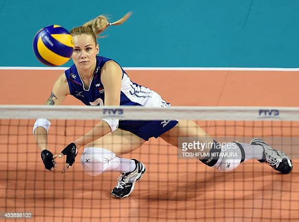 Russia's libero Svetlana Kryuchkova eyes the ball during their women's volleyball World Grand Prix final round second day match against Belgium in...