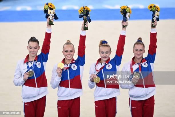 Russia's Liliia Akhaimova, Russia's Angelina Melnikova Russia's Viktoriia Listunova and Russia's Vladislava Urazova celebrate after winning the...