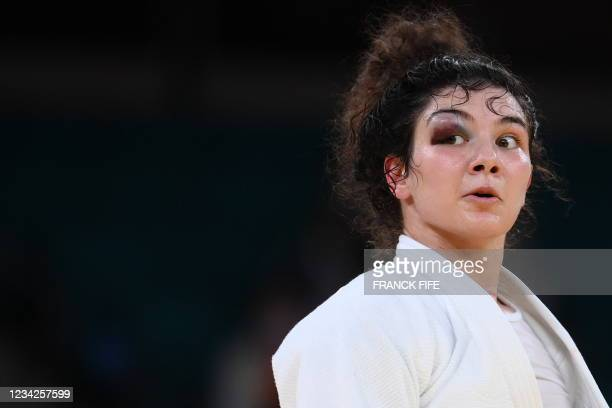 Russia's Madina Taimazova competes against Japan's Chizuru Arai in the judo women's -70kg semifinal B bout during the Tokyo 2020 Olympic Games at the...