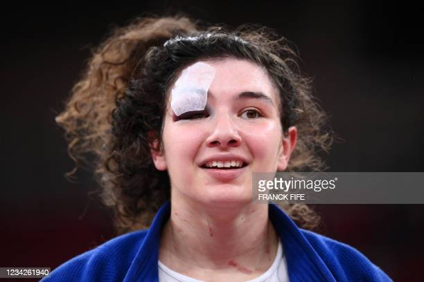 Russia's Madina Taimazova reacts after defeating Croatia's Barbara Matic in the judo women's -70kg bronze medal A bout during the Tokyo 2020 Olympic...