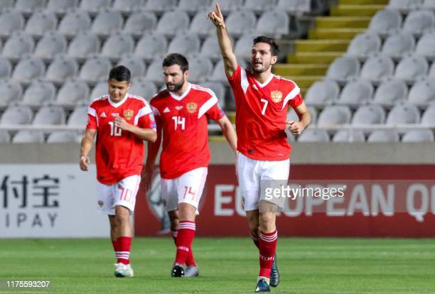 Russia's Magomed Ozdoyev celebrates his goal during the EURO 2020 group I qualifiers football match between Cyprus and Russia at the GSP stadium in...