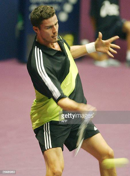 Russia's Marat Safin hits a forehand to his French opponent Fabrice Santoro during their Lyon's ATP tournament 07 October 2003 at the Palais des...