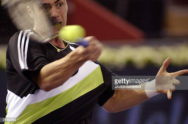 Russia''s Marat Safin returns a ball to his Swedish opponent Jonas Bjorkman during their Madrid Masters Series first round match 14 October 2003 at...
