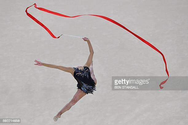 TOPSHOT Russia's Margarita Mamun competes in the individual allaround qualifying event of the Rhythmic Gymnastics at the Olympic Arena during the Rio...