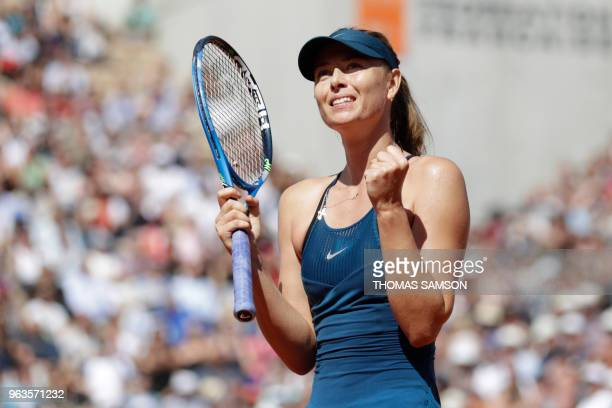 Russia's Maria Sharapova celebrates after victory against Netherland's Richel Hogenkamp at the end of their women's singles first round match on day...