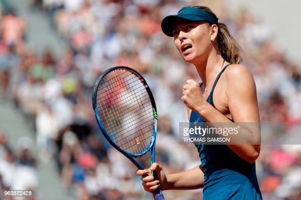 TOPSHOT Russia's Maria Sharapova celebrates after victory against Netherland's Richel Hogenkamp at the end of their women's singles first round match...