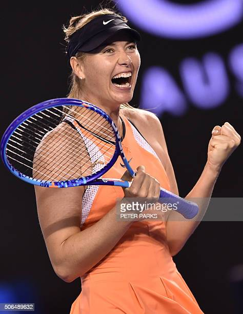 Russia's Maria Sharapova celebrates after victory in her women's singles match against Switzerland's Belinda Bencic on day seven of the 2016...