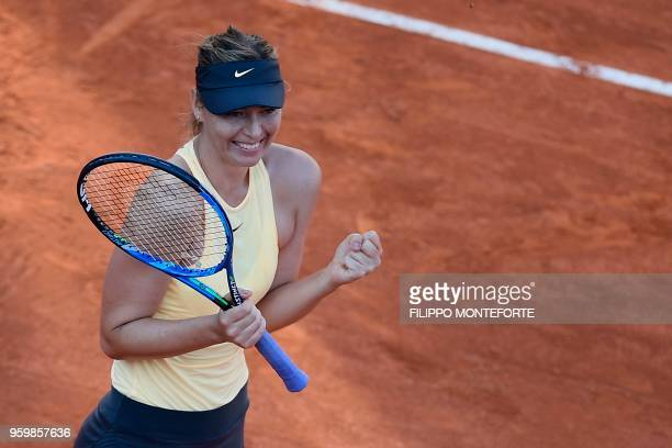 TOPSHOT Russia's Maria Sharapova celebrates after winning the quarter final match against Latvia's Jelena Ostapenko at Rome's WTA Tennis Open...