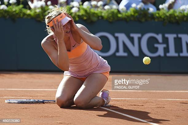 Russia's Maria Sharapova celebrates as she wins the French tennis Open final match against Romania's Simona Halep at the Roland Garros stadium in...