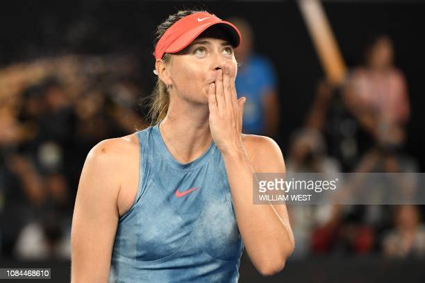 TOPSHOT Russia's Maria Sharapova celebrates her victory against Denmark's Caroline Wozniacki during their women's singles match on day five of the...