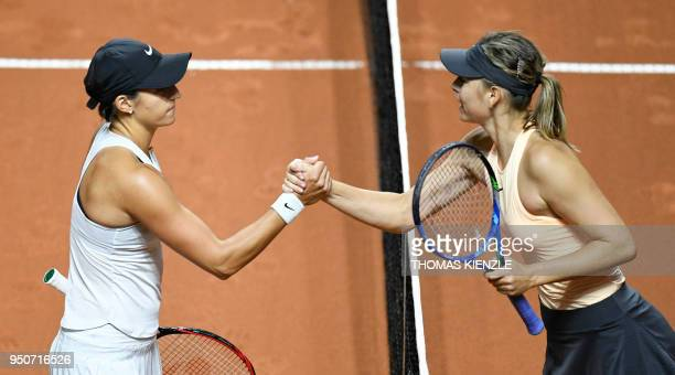 Russia's Maria Sharapova congratulates France's Caroline Garcia after she won their tennis match at the WTA Tennis Grand Prix on April 24 2018 in...